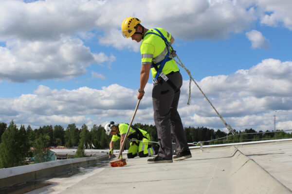 fall protection snow removal xsplatforms icehockey arena finland man in van xslinked sloping roof