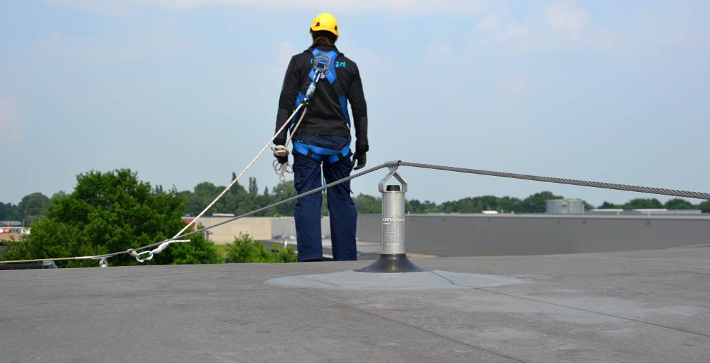 Horizontal lifeline system on sloping roof
