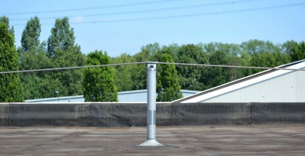 Extended horizontal lifeline system on roof of aluminum processing company